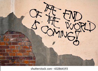 The End Of THe World Is Coming - Handwritten graffiti sprayed on the wall, anarchist aesthetics. Warning on ecological catastrophe, explosion of nuclear weapon, crash with asteroid, pandemics