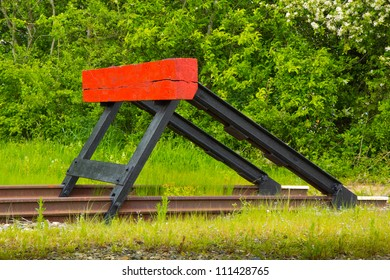 an end-block of a rail track with a green background