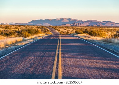 endless asphalt road with blue sky in Big Bend National Park, Texas, USA