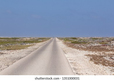 Endless asphalt road to the most southern point of the tropical island of Bonaire in the caribbean
