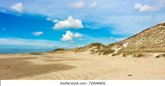 Endless beach and dune view near Camperduin in the netherlands. North sea holiday in northern holland. Travel photo.