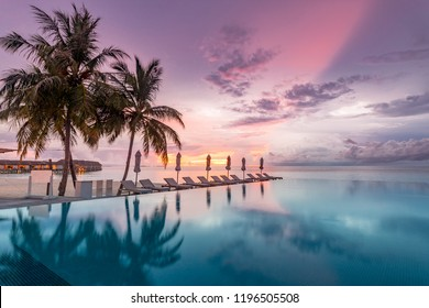 Endless beach pool, sunset sky horizon and colorful clouds. Luxury vacation and holiday concept. Sunset sunrise landscape, outdoor scenic