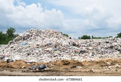 endless big heap trash on dumping ground