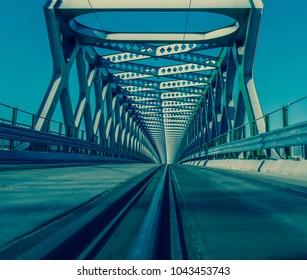 Endless bridge with rails