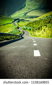 Endless curvy road through the hills of Flores island, the Azores, Portugal.