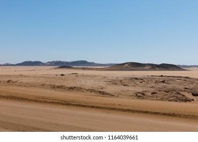 Endless gravel roads to Cape Cross, Namibia.