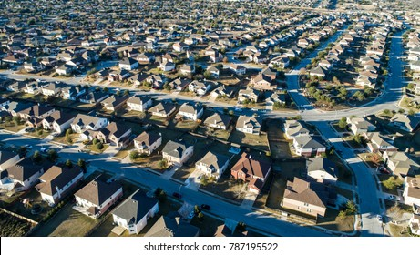 Endless houses in a Suburb. Aerial drone view afternoon hours with long shadows and thousands upon thousands of homes. Little boxes , all the same in a huge neighborhood in Round Rock , Texas.