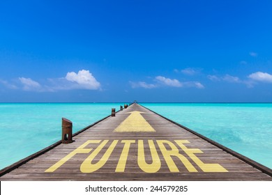 endless jetty with an yellow arrow  leading over a turquoise sea  to the horizon. On the jetty is written the word future. Concept for proceeding to future.