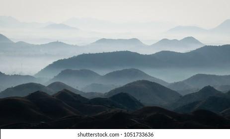 Endless mountains layers fading to white