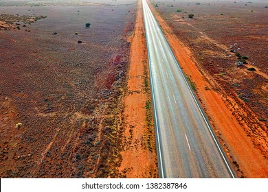Endless road across the remote Australian bush