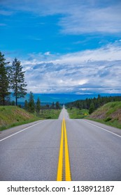 Endless road in a beautiful scenery. The yellow lines draws you into the picture.