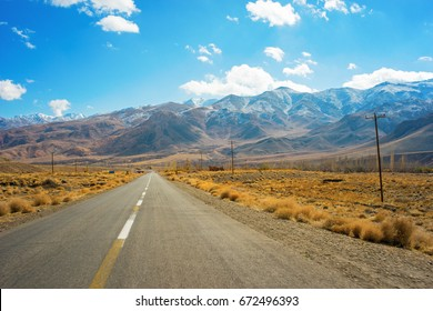 Endless road crossing a mountain landscape in Isfahan province, Iran.