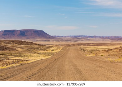 Endless roads in a breathtaking landscape, Skeleton Coast Park, Namibia.