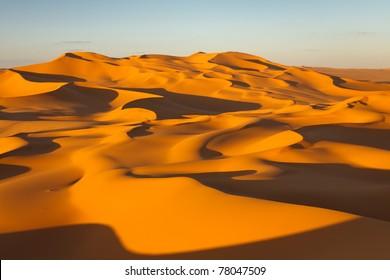 Endless sand dunes at sunset - Murzuq Desert, Sahara, Libya