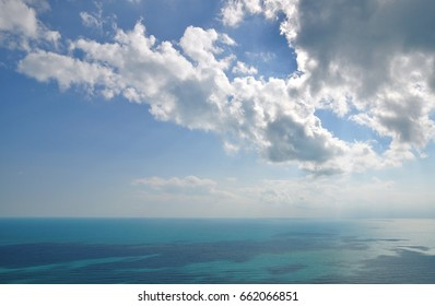 endless sky with beautiful clouds over turquoise sea