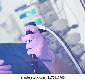 Endoscopic medical device in the hands of a surgeon's. Endoscopist is ready to work with the patient.
