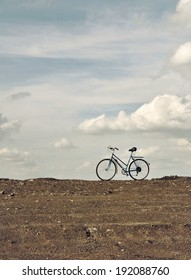 Ends of the earth. Bike at sky background.