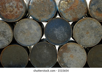 The ends of a stack of slightly rusted metal drums