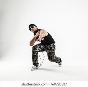 energetic and charismatic guy rapper dances break dance