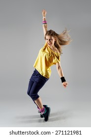 Energetic dancing woman screaming doing exercise. Young beautiful jazz girl in motion.