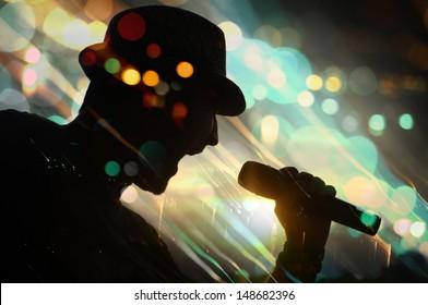 energetic singer. silhouette.