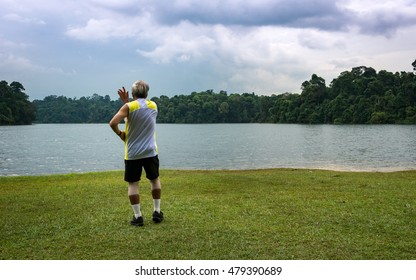 Energize Your Self, an old man doing his daily moves infront of an amazing view, discharging all his negative energy.