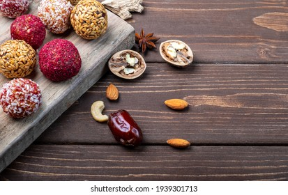 Energy balls on an old wooden board and on a wooden background.