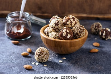Energy balls, vegan raw sweets, homemade dessert with almond and cacao, sesam and oats
