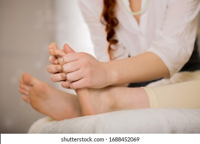 Energy cleansing feet in a stream of reiki. Foot massage