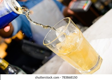 Energy drink being poured at a bar