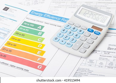Energy efficiency chart and neat calculator over it - close up shot