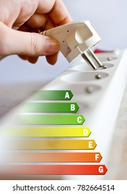 Energy efficiency label for house / electricity and money savings - plug in a hand