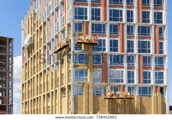 Energy efficiency wall renovation for energy saving. Exterior house wall heat insulation with mineral wool, building under construction
