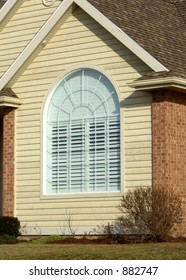 Energy efficient arched window in a new home