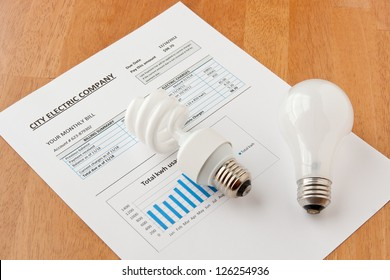 Energy efficient and incandescent  bulbs on electric bill. Energy efficient house concept.