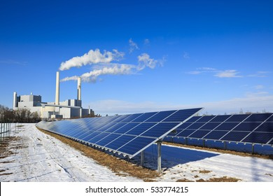 Energy - rack of solar panels and thermal power plant