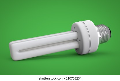 Energy saving bulb isolated on green background