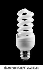 Energy saving fluorescent light bulb isolated on black
