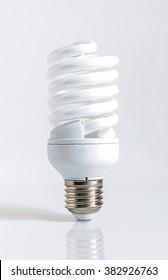 Energy saving fluorescent lightbulb on a white background