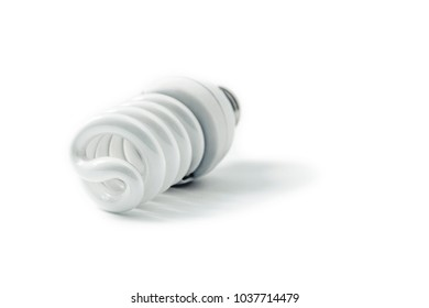 Energy saving fluorescent spiral light bulb on white background. Diagonal view. Shallow depth of field.