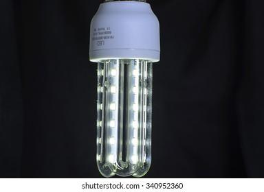Energy saving LED light bulb on a black background.