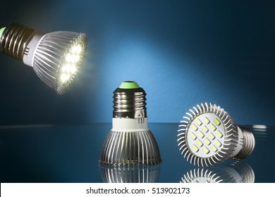 Energy saving  led lights on a glass table and blue background