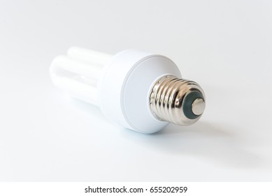 Energy saving light bulb. Compact-fluorescent on white background, shallow focus.