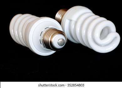 energy saving light bulb on black background