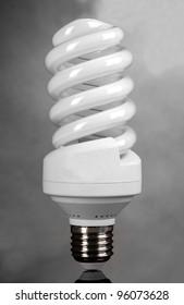 energy saving light bulb on gray background