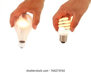 Energy saving light bulbs in hand on white background