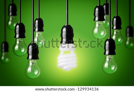 Energy saving and simple light bulbs.Green background