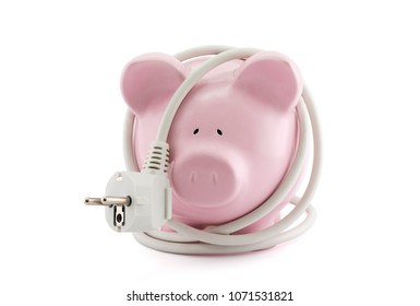 Energy Savings concept. Piggy bank with power plug. Clipping path included.