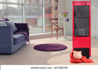 Energy savings concept. Solid fuel boiler and piggy bank in living room