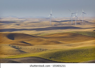 Energy wind turbines on the fall wheat fields of the Palouse in Washington state